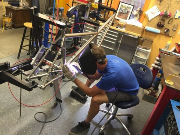 Brad Bingham, who designed the dual suspension bike, doing his thing, welding a tandem frame. The guy is an artist.