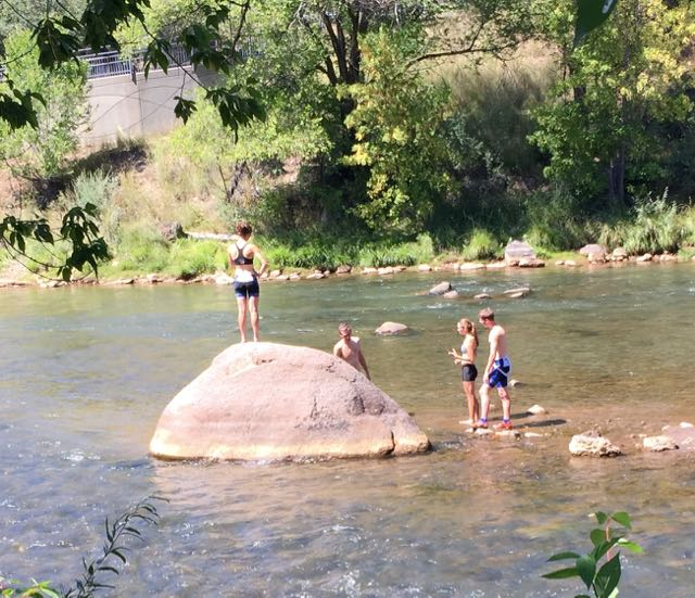 The Endersbe kids, Carley and Libbey, after the ride, enjoying the Animas River. They go to school at Fort Lewis.
