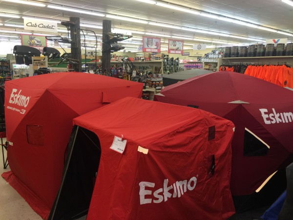 Ice fishing tents, with deer stands behind.