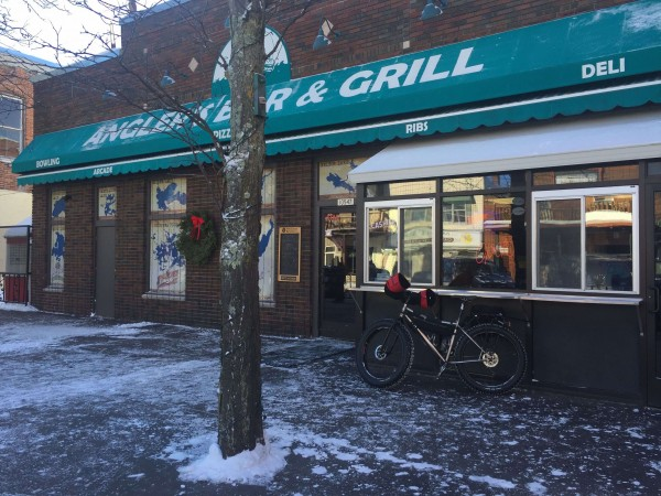 You don't often see a $10000 Fatbike parked in front of a bar at noon when it is -10 out.