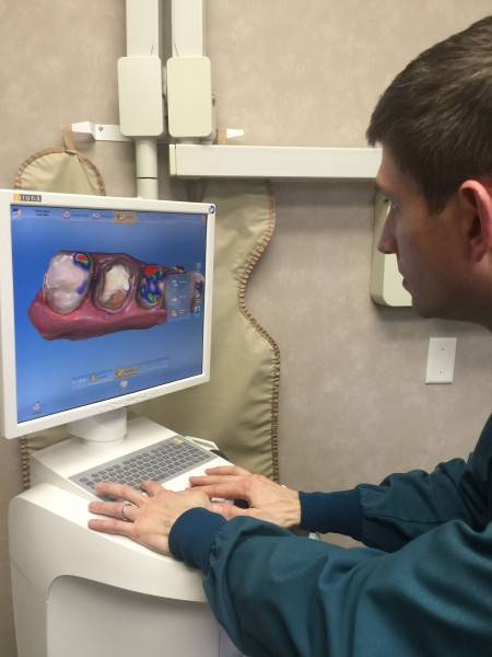 Modern dentistry is super cool. This is Dr. David Gilmer looking at a 3D image he took.