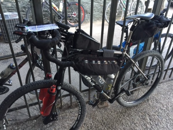 "So many different bikes. This is Corey ""Cornbread"" Godfrey's machine. He has $20 of pennies in the frame bag. He's training for the Great Divide race. No thanks."