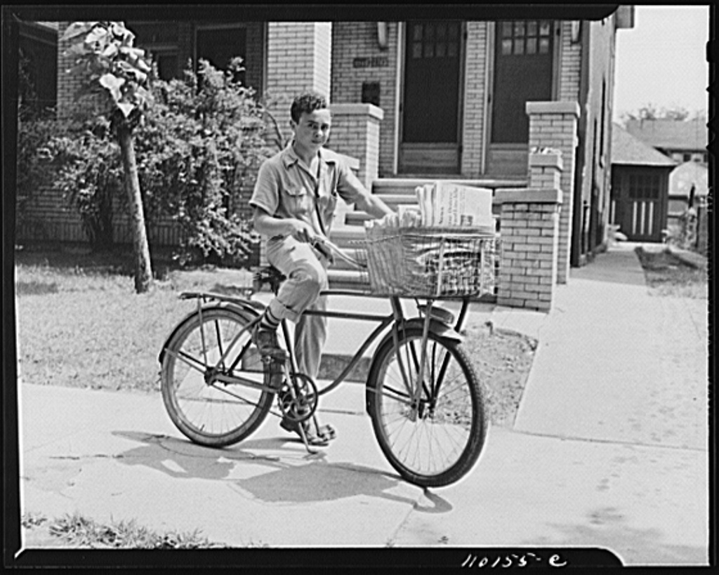 This could have been me, but I was riding a Schwinn Colligate and had baskets on the back too.