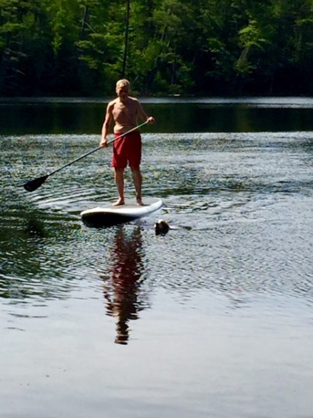 Dennis paddling in with Tucker.
