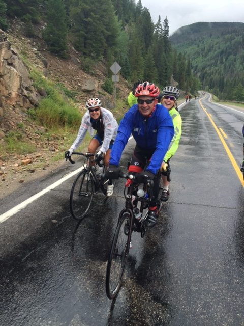 Sue, Bill and Laura climbin up towards Minturn in the rain.