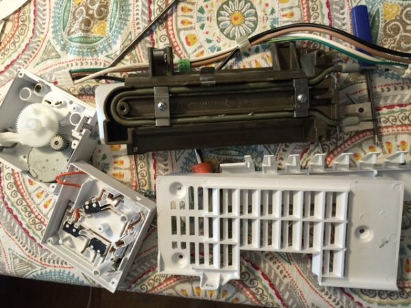 Ice maker disassembled on my kitchen table.