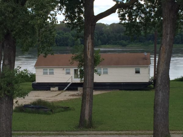 I saw this house by the Mississippi River yesterday out riding. It is build on a boat with poles beside it so it can just raise up when the river floods.