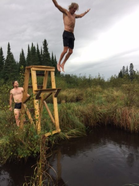 Taking the plunge, in the swamp, after the wood fired sauna.