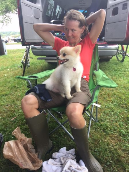 Catherine and their dog, Jason, after her race.