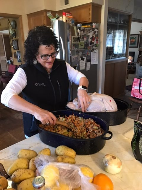 Stacie putting stuffing in the turkey.