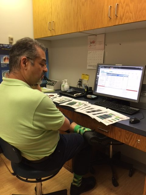 Dr. Marefat looking over all the data he collected. Super good guy.