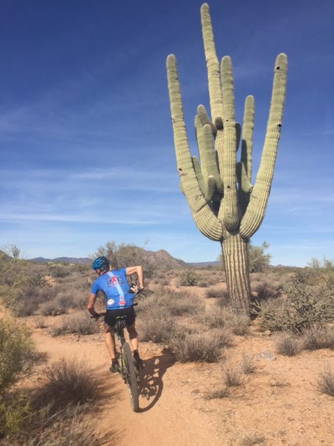 There are lots of cactus around.  Vincent can't seem to keep both hands on the bars much.